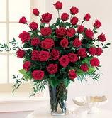 Eryaman çiçekçi telefonları eryaman çiçek  12 adet essiz kirmizi gül demeti cam yada mika vazoda